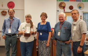 David Morrill (Vice-president NAARA), Penny Buick receiving a VHF/UHF radio, Patty Marsh (ACS DR Director), Jack Tiley (ARRL Eastern WA Technical Coordinator), Carlos Antuna (President NAARA)